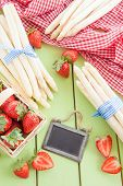 image of white asparagus  - White asparagus and fresh strawberries in early summer season - JPG