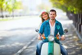 picture of scooter  - Young couple on a scooter outdoors - JPG