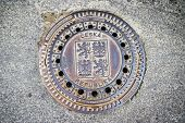 pic of paved road  - Hatch of sewage on the paving road in Tabor Czech Republic - JPG