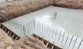 stock photo of reinforcing  - Foundation of a new house with reinforced concrete - JPG