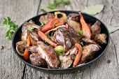 picture of liver fry  - Grilled chicken liver with pepper in frying pan on wooden table close up view - JPG