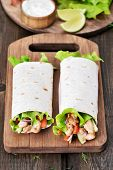 stock photo of sandwich wrap  - Wrap sandwiches with chicken meat and vegetables - JPG