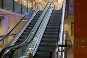 foto of escalator  - two lighted escalators in the shoping centre - JPG