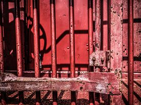 foto of caboose  - Closeup of an old red caboose red paint - JPG