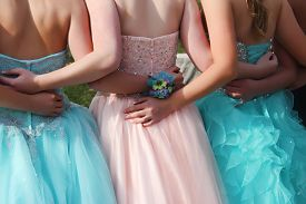 stock photo of  friends forever  - Best friends forever in a group hug all dressed up - JPG