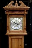 stock photo of pendulum clock  - Antique grandfather clock with delicately carved case - JPG