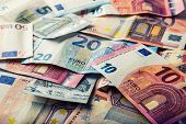 Постер, плакат: Euro banknotes Euro money Euro currency Banknotes stacked on each other in different positions Se