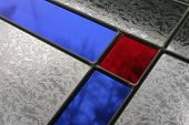 stock photo of stained glass  - Close up of stained glass window in a church - JPG