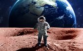 Brave astronaut at the spacewalk on the mars. This image elements furnished by NASA. poster