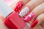 Valentine Nail art manicure. Valentines Day Holiday style bright Manicure with painted hearts and po poster