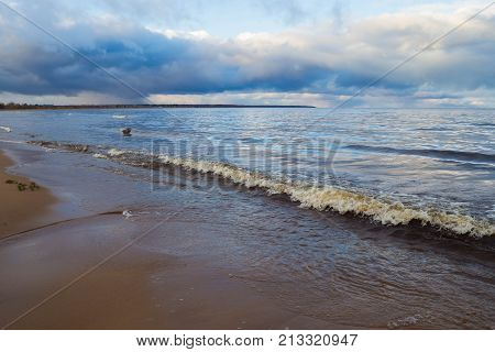 poster of Storm Landscape sea waves on background the cloudy sky. The natural elements water Ocean waves. Wild sea storm - hazardous weather. The waves lapping on the shore.