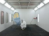 stock photo of paint spray  - The image of painter works in a spray booth - JPG