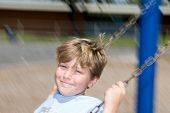 stock photo of swingset  - Kid playing on a school - JPG