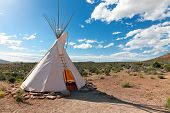 stock photo of teepee  - Teepee in american prairie near Grand Canyon Skywalk build by Hulapai tribe - JPG