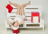 Santa Claus Girl With Gift On Bench. poster