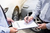 Car Insurance Agent Send A Pen To His Customers Sign The Insurance Form On Clipboard While Examining poster