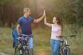 Happy Couple With Bikes Funs In Pine Forest poster