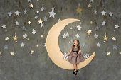Little Girl In Sitting On Big Moon. Little Girl Dreaming poster