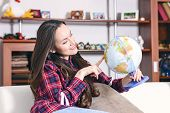Go On An Adventure. Woman Dreaming About Traveling Around The World, Looking At The Globe In Room Of poster