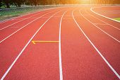 White Lines Of Stadium And Texture Of Running Racetrack Red Rubber Racetracks In Outdoor Stadium Are poster