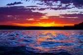 Stunning Pink, Yellow, And Blue Sunset Reflected On The Water At Wahweap Bayin The Arizona Portion O poster
