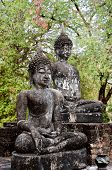 Seated Buddha Statues In Famous Sukhothai Historical Park, A Unesco World Heritage Site, The Ancient poster