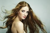 foto of flowing hair  - Portrait of young beautiful woman with long flowing hair - JPG