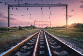 Railroad And Pink Sky At Sunset. Summer Rural Industrial Landscape With Railway Station, Sky With Co poster