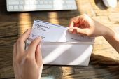 Businessperson Opening Envelope With Paycheck poster