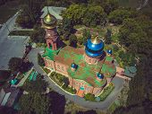Red Brick Christian Church With Golden Domes. Christian Temple In Russia. The Church Of The Christia poster