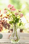 Vase Of Roses Flowers Background. Vase With Rose Flowers On White Table Background. Background Image poster