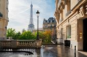 Cosy Paris Street With View On The Famous Eiffel Tower On A Cloudy Summer Day, Paris France poster