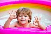 Child Boy And Best Swimming Pool. Child Swimming Pool. Children Fun. Child Water Toys. Cute Kid Rela poster