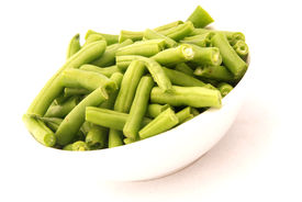 picture of green bean  - A bowl of fresh cut green beans isolated on white background - JPG