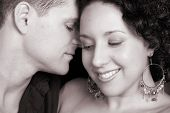 stock photo of semi-formal  - Young couple in love faces close to one another - JPG