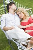 Couples Sleeping In Hammock