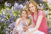 pic of mother daughter  - Families walking through springtime gardens - JPG