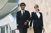 picture of cabin crew  - Airplane cabin crew walking together at the airport with bags - JPG