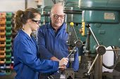 foto of electrical engineering  - Two machinists working on machine - JPG