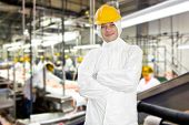 stock photo of slaughterhouse  - Smiling worker in a meat processing factory and slaughterhouse - JPG