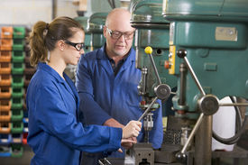 image of electrical engineering  - Two machinists working on machine - JPG