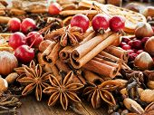 pic of christmas spices  - Christmas spices fruits nuts and berries on the wooden background - JPG