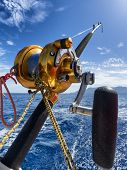 image of game-fish  - fishing reel and pole in boat during big game - JPG