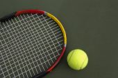 stock photo of escuela  - Yellow tennis balls on the tennis court - JPG