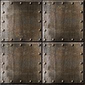 stock photo of ironclad  - rusty metal armour background with rivets - JPG