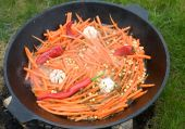 stock photo of dutch oven  - Traditional pilaf cooked in qozon outdoors - JPG