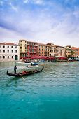 picture of gondolier  - Gondolier driving gondolla on the Grand canal in Venice Itally