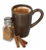 brown mug with cinnamon beverage and cinnamon sticks on white background