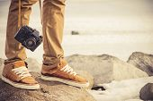 foto of swag  - Feet man and vintage retro photo camera outdoor Travel Lifestyle vacations concept