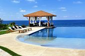 stock photo of pergola  - Pavilion and swimming pool in luxury resort - JPG
